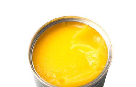 ghee: Indian ghee in a tin can over white background Stock Photo