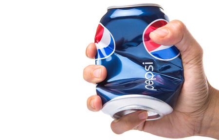 illustrative: KUALA LUMPUR, MALAYSIA - JANUARY 13TH, 2015. Crumpled Pepsi can. Editorial