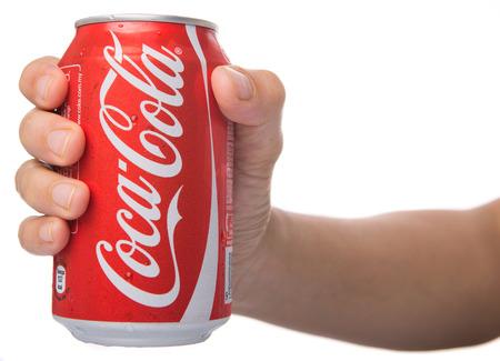 KUALA LUMPUR, MALAYSIA - JANUARY 13TH, 2015. Holding a can of Coca Cola Editorial