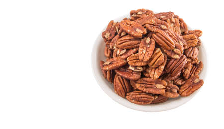 hickory nuts: Pecan nut in a white bowl over white background