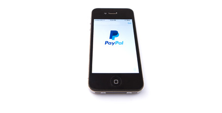 Kuala Lumpur, Malaysia - January 16th, 2015. Paypal mobile apps. Established in 1998, PayPal is an international e-commerce business and one of the world
