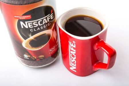 nescafe: KUALA LUMPUR, MALAYSIA - JANUARY 17TH, 2015. Nescafe is a brand of instant powdered coffee made by Nestle S.A, a Swiss multinational food and beverage company, first introduced on April 1, 1938.