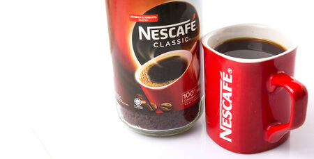 nestle: KUALA LUMPUR, MALAYSIA - JANUARY 17TH, 2015. Nescafe is a brand of instant powdered coffee made by Nestle S.A, a Swiss multinational food and beverage company, first introduced on April 1, 1938.