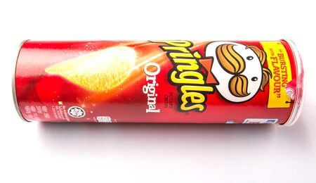 billion: KUALA LUMPUR, MALAYSIA - JANUARY 19TH 2015. Owned by the Kellogg Company, Pringles is a brand of potato snack chips sold in 140 countries with yearly sales of more than US 1.4 billion dollars. Editorial