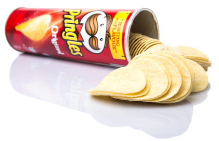 stackable: KUALA LUMPUR, MALAYSIA - JANUARY 19TH 2015. Owned by the Kellogg Company, Pringles is a brand of potato snack chips sold in 140 countries with yearly sales of more than US 1.4 billion dollars. Editorial