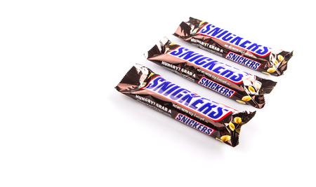 KUALA LUMPUR, MALAYSIA - JANUARY 21ST 2015. Introduced in 1930, Snickers chocolate bar is produced by Mars Incorporated and has an annual global sales of US $2 billion. Editorial