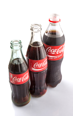 addictive drinking: KUALA LUMPUR, MALAYSIA - JANUARY 23RD 2015. Coca Cola drinks are produced and manufactured by The Coca-Cola Company, an American multinational corporation and sold in over 200 countries worldwide.