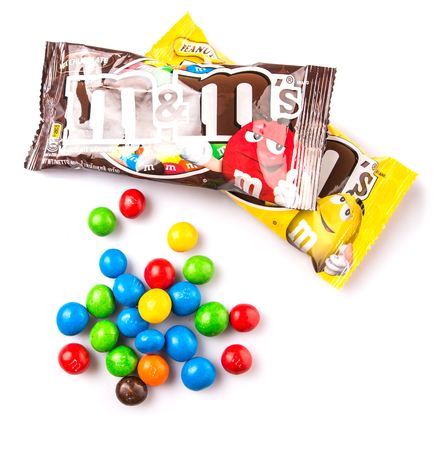 KUALA LUMPUR, MALAYSIA - JANUARY 23RD, 2015. MM are colorful button shape candies produced by Mars Incorporated, introduced in 1941 and currently being sold in as many as 100 countries worldwide.