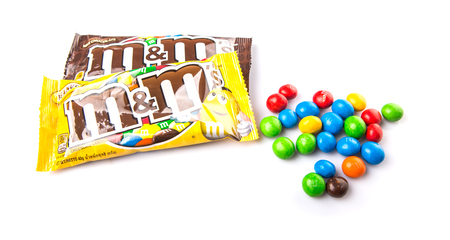 mars incorporated: KUALA LUMPUR, MALAYSIA - JANUARY 23RD, 2015. MM are colorful button shape candies produced by Mars Incorporated, introduced in 1941 and currently being sold in as many as 100 countries worldwide.