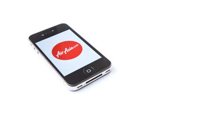 frequent: KUALA LUMPUR, MALAYSIA, JANUARY 25TH 2015. Air Asia mobile apps. AirAsia is a Malaysian low-cost airline based in Kuala Lumpur, Malaysia and operates flights to 100 destinations spanning 22 countries. Editorial