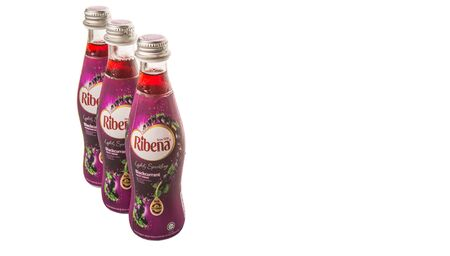 billion: KUALA LUMPUR, MALAYSIA - JANUARY 24TH 2015. Ribena is a concentrated soft and fruit drink by British GlaxoSmithKline company. In 2013 it was purchased by Suntory Holdings Limited for US 1.35 billion. Editorial