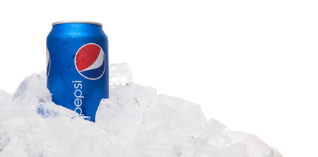 carbonated drink: KUALA LUMPUR, MALAYSIA - FEBRUARY 2ND 2015. Pepsi can drink on ice. Pepsi is a carbonated soft drink produced and manufactured by PepsiCo Inc. an American multinational food and beverage company. Editorial