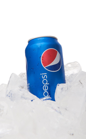 carbonated: KUALA LUMPUR, MALAYSIA - FEBRUARY 2ND 2015. Pepsi can drink on ice. Pepsi is a carbonated soft drink produced and manufactured by PepsiCo Inc. an American multinational food and beverage company. Editorial