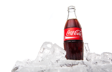 KUALA LUMPUR, MALAYSIA - FEBRUARY 5TH, 2015. A bottle of Coca Cola soft drinks. Coca Cola drinks are produced and manufactured by The Coca-Cola Company, an American multinational beverage corporation Editorial