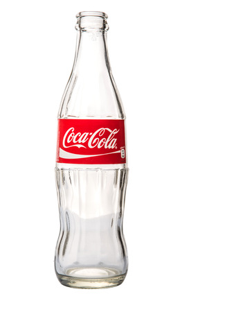 KUALA LUMPUR, MALAYSIA - FEBRUARY 7TH, 2015. Empty Coca Cola bottle. Coca Cola drinks are produced and manufactured by The Coca-Cola Company, an American multinational beverage corporation.