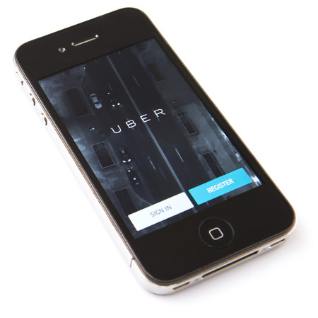 KUALA LUMPUR, MALAYSIA - FEBRUARY 8TH 2015. Uber mobile apps. Uber is smartphone app-based transportation network and taxi company operating in 53 countries around the world. Editorial