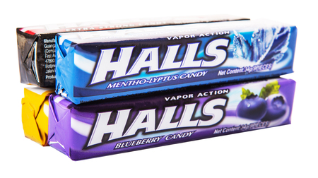KUALA LUMPUR, MALAYSIA - FEBRUARY 11TH, 2015. Halls is the brand name of a popular mentholated cough drop and sold by the Cadbury-Adams Division of Cadbury, now owned by Mondelez International.