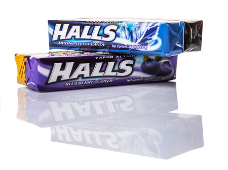 adams: KUALA LUMPUR, MALAYSIA - FEBRUARY 11TH, 2015. Halls is the brand name of a popular mentholated cough drop and sold by the Cadbury-Adams Division of Cadbury, now owned by Mondelez International.