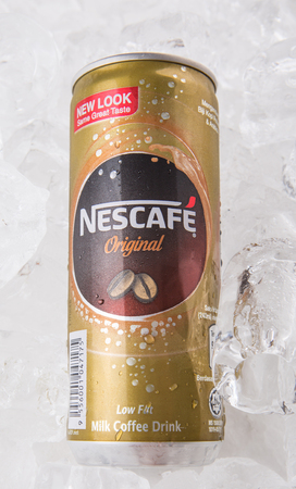 nestle: KUALA LUMPUR, MALAYSIA - FEBRUARY 13TH 2015. Nescafe can drink. Nescafe is a brand of instant coffee made by Nestle, a Swiss multinational food and beverage company, first introduced on April 1, 1938. Editorial