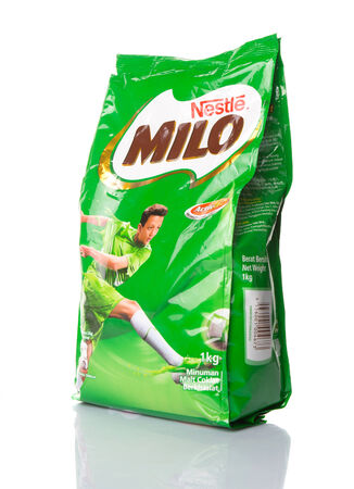 nestle: KUALA LUMPUR, MALAYSIA - FEBRUARY 15TH 2015. Produced by Nestle, Milo is a chocolate malt powder which is mixed with water or milk to produce a popular beverage in Asia, Australia and New Zealand.