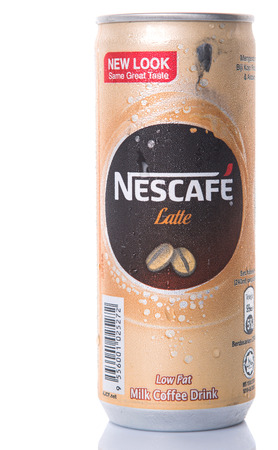 nescafe: KUALA LUMPUR, MALAYSIA - FEBRUARY 13TH 2015. Nescafe Latte can drink. Nescafe is an instant coffee made by Nestle, a Swiss multinational food and beverage company, first introduced on April 1, 1938.