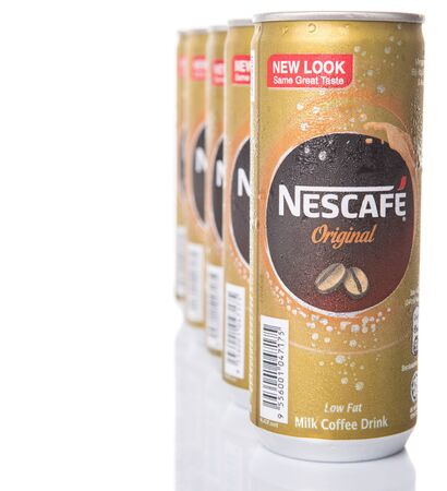 nescafe: KUALA LUMPUR, MALAYSIA - FEBRUARY 13TH 2015. Nescafe can drink. Nescafe is a brand of instant coffee made by Nestle, a Swiss multinational food and beverage company, first introduced on April 1, 1938. Editorial