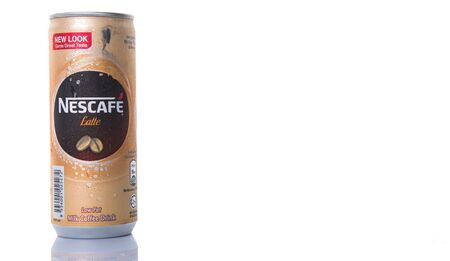 nestle: KUALA LUMPUR, MALAYSIA - FEBRUARY 13TH 2015. Nescafe Latte can drink. Nescafe is an instant coffee made by Nestle, a Swiss multinational food and beverage company, first introduced on April 1, 1938.
