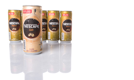 nescafe: KUALA LUMPUR, MALAYSIA - FEBRUARY 13TH 2015. Nescafe can drinks. Nescafe is an instant coffee brand made by Nestle, a Swiss multinational food and beverage company, first introduced on April 1, 1938.
