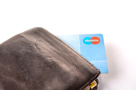 mastercard: KUALA LUMPUR, MALAYSIA - FEBRUARY 19Th 2015. Maestro debit card in old wallet. Maestro is a multi-national debit card service owned by MasterCard Incorporated that was founded in 1992. Editorial