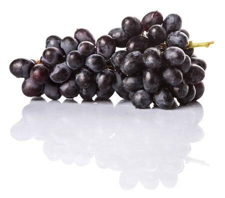 Black grapes over white background