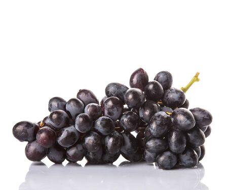 seedless: Black grapes over white background
