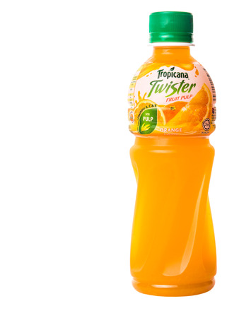 tropicana: KUALA LUMPUR, MALAYSIA - FEBRUARY 22ND 2015. Tropicana bottled orange fruit juices. Tropicana Products Inc. is an American fruit juice multinational company and has been owned by PepsiCo since 1998. Editorial