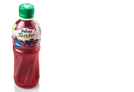 tropicana: KUALA LUMPUR, MALAYSIA - FEBRUARY 22ND 2015. Tropicana blackcurrant fruit juice. Tropicana Products Inc. is an American fruit juice multinational company and has been owned by PepsiCo since 1998.