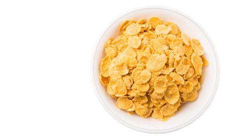 yellowrn: Corn flakes breakfast cereal in a white bowl over white background