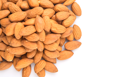 drupe: Raw almond nut over white background