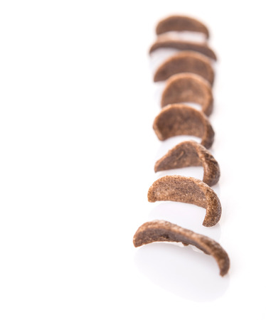 crunchy: Crunchy chocolate breakfast cereal over white background