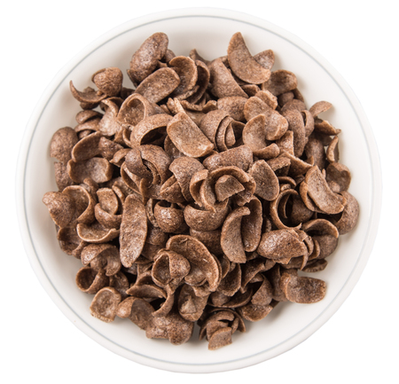 crunchy: Crunchy chocolate breakfast cereal in white bowl over white background