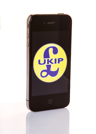 rightwing: KUALA LUMPUR, MALAYSIA - MARCH 2ND 2015. UKIP logo on Iphone. Founded in 1993, The UK Independence Party, commonly known as UKIP is a right-wing political party in the United Kingdom.