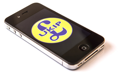 populist: KUALA LUMPUR, MALAYSIA - MARCH 2ND 2015. UKIP logo on Iphone. Founded in 1993, The UK Independence Party, commonly known as UKIP is a right-wing political party in the United Kingdom.