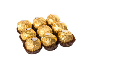 ferrero: KUALA LUMPUR, MALAYSIA - MARCH 3RD 2015. Introduced in 1982, Ferrero Rocher is a chocolate brand made by Italian manufacturer Ferrero SpA. Ferrero SpA is the biggest chocolate producer in the world.