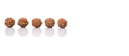 Chocolate balls with nuts over white background