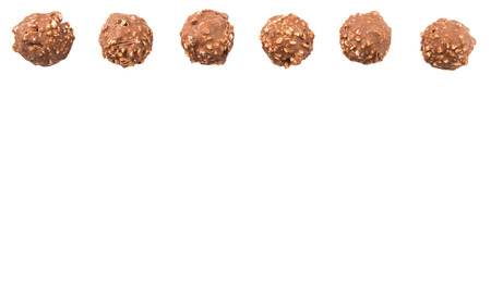 chocolate balls: Chocolate balls with nuts over white background