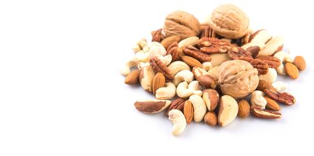 kulinarne: Mix culinary nuts over white background Zdjęcie Seryjne