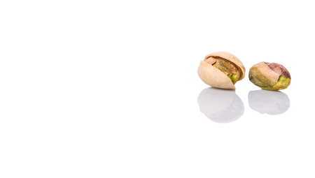whitern: Pistachio nuts over white background