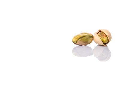 whitern: Pistachio nuts over white background