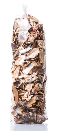 Potpourri materials in plastic package over white background Stock Photo