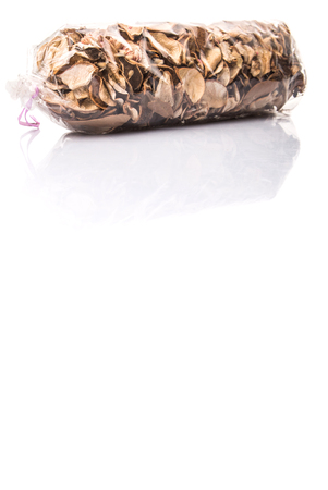whitern: Potpourri materials in plastic package over white background Stock Photo