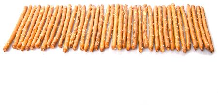 pretzel stick: Brown, delicious pretzel sticks over white background