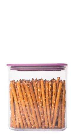 pretzel stick: Brown, delicious pretzel sticks in a plastic container over white background Stock Photo