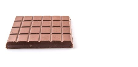 Dark brown chocolate bars over white background